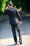 Uomo di affari con il telefono Fotografie Stock Libere da Diritti