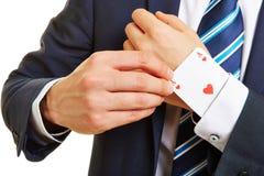 Uomo di affari con l'asso sulla sua manica Immagini Stock