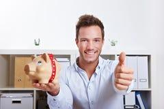 Uomo di affari con la banca piggy Fotografia Stock