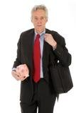 Uomo di affari con la banca piggy Fotografie Stock Libere da Diritti