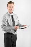 Uomo di affari con la lavagna per appunti Immagini Stock