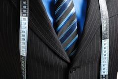 Uomo di affari con la misura di nastro Fotografia Stock Libera da Diritti