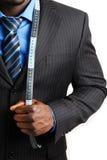 Uomo di affari con la misura di nastro Fotografie Stock