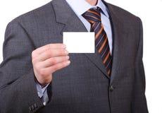 Uomo di affari con la scheda personale in bianco Fotografia Stock