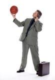 Uomo di affari con la sfera del cestino ed il telefono delle cellule Fotografia Stock Libera da Diritti