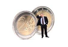 Uomo di affari con le monete degli euro Fotografia Stock Libera da Diritti