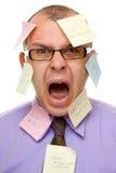 Uomo di affari con le note appiccicose Immagini Stock Libere da Diritti