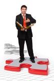 Uomo di affari con le soluzioni Immagine Stock