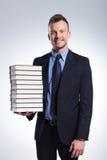 Uomo di affari con molti libri Fotografia Stock