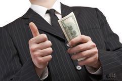Uomo di affari con soldi in sua mano Fotografia Stock