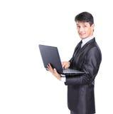 Uomo di affari con un computer portatile fotografia stock