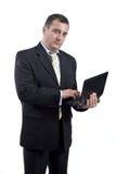 Uomo di affari con un computer portatile in sue mani Fotografia Stock