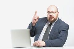 Uomo di affari con un dito alzato Fotografia Stock