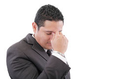Uomo di affari con un dolore capo Fotografie Stock