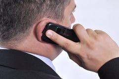 Uomo di affari con un telefono mobile Immagine Stock Libera da Diritti