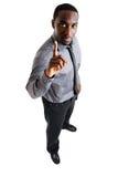 Uomo di affari con una barretta in su fotografia stock