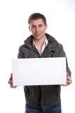 Uomo di affari con una scheda bianca vuota Fotografia Stock