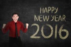 Uomo di affari davanti a scrittura 2016 del buon anno Fotografia Stock