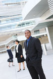 Uomo di affari dell'afroamericano con la squadra Fotografie Stock Libere da Diritti