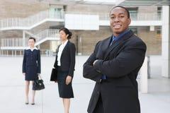 Uomo di affari dell'afroamericano con la squadra Fotografia Stock Libera da Diritti