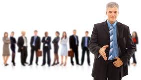 Uomo di affari e la sua squadra isolati Immagini Stock Libere da Diritti