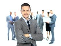 Uomo di affari ed il suo gruppo sopra un fondo bianco Immagini Stock Libere da Diritti