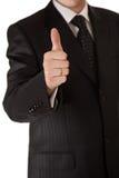 Uomo di affari in pollici del vestito in su Fotografie Stock