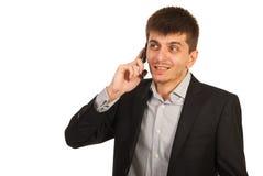 Uomo di affari sul cellulare del telefono Fotografie Stock Libere da Diritti
