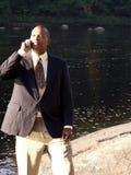 Uomo di affari sulla cella Fotografia Stock