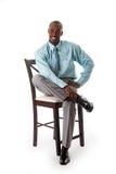 Uomo di affari sulla presidenza Fotografie Stock Libere da Diritti