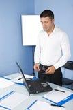 Uomo di affari in ufficio Fotografia Stock