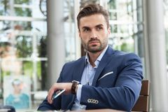 Uomo di affari in un caffè Fotografia Stock