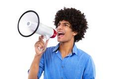 Uomo di afro con il megafono Fotografia Stock
