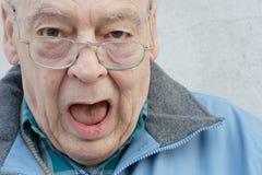 Uomo di anziani con la bocca aperta Immagini Stock Libere da Diritti