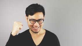 Uomo di Asain con fondo grigio fotografie stock