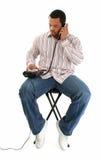 Uomo di Atractive con il telefono della linea terrestre immagini stock libere da diritti