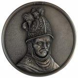 Uomo di bassorilievo in un casco dorato Fotografia Stock