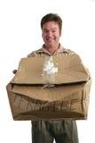 Uomo di consegna nella smentita Immagine Stock Libera da Diritti