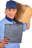 Uomo di consegna sorridente Immagini Stock