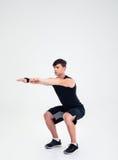 Uomo di forma fisica che fa occupando gli esercizi Immagine Stock