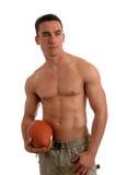 Uomo di gioco del calcio fotografia stock