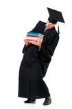 Uomo di graduazione che porta i libri pesanti Immagini Stock Libere da Diritti