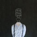 Uomo di idea ambientale intelligente con la testa della lampadina del gesso Fotografia Stock Libera da Diritti