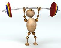 Uomo di legno che alza barbell pesante Fotografia Stock Libera da Diritti