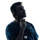 Uomo di medico sulla siluetta del telefono Fotografia Stock