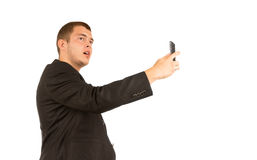 Uomo di medio evo che prende l'immagine di auto facendo uso del telefono Fotografia Stock Libera da Diritti