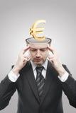 Uomo di mentalità aperta con l'euro segno dell'oro 3d all'interno Fotografia Stock Libera da Diritti
