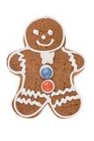 Uomo di pan di zenzero di Natale isolato su un fondo bianco Immagine Stock