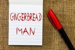 Uomo di pan di zenzero del testo della scrittura Biscotto di significato di concetto fatto solitamente del pan di zenzero sotto f immagini stock libere da diritti