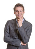 Uomo di pensiero di affari in vestito grigio Fotografia Stock Libera da Diritti